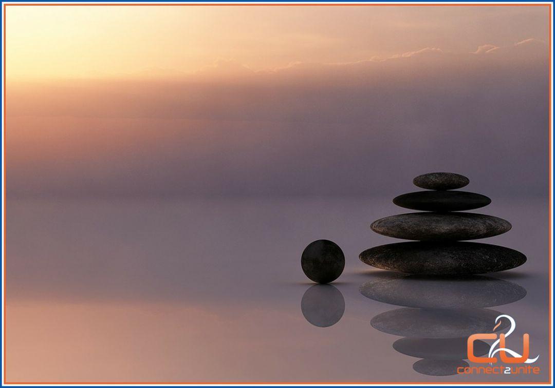 In balans als stenen op elkaar met massage van Eszensa Wellness
